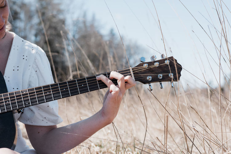 Man playing guitar on field