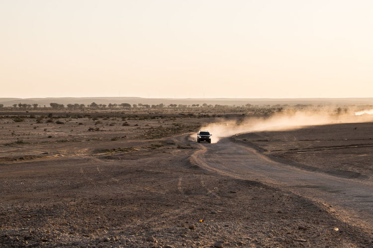 4x4 Adventure Beauty In Nature Car Clear Sky Day Dirt Road Land Vehicle Motorsport Nature No People Off-road Vehicle Outdoors Sky Sunset Tire Track Transportation Wonderlust