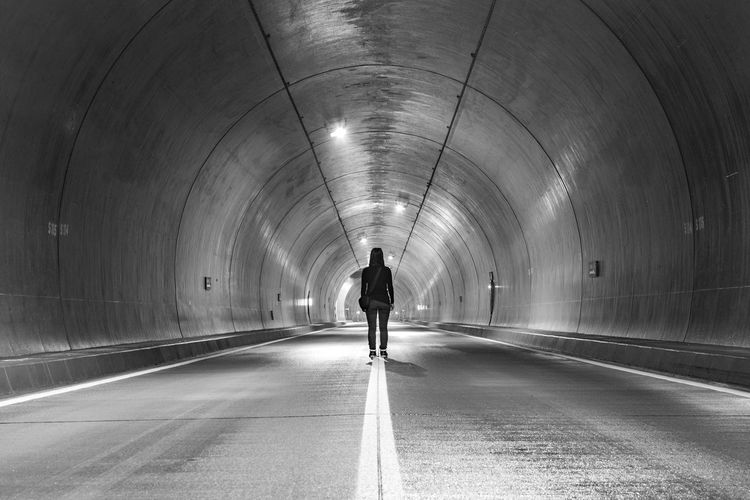 Tunnel vision ASIA Alone Copy Space Hokkaido Japan Lines Perspective Silhouette Standing Woman Adult Adults Only Architecture Black And White Built Structure Day Full Length Girl Illuminated Indoors  Leisure Activity Lifestyles Men One Man Only One Person People Real People Rear View Road The Way Forward Transportation Tunnel Underground Unrecognizable Person Walking Wet Young Adult An Eye For Travel The Graphic City Mobility In Mega Cities Go Higher Inner Power Adventures In The City The Architect - 2018 EyeEm Awards The Traveler - 2018 EyeEm Awards The Street Photographer - 2018 EyeEm Awards #urbanana: The Urban Playground Humanity Meets Technology