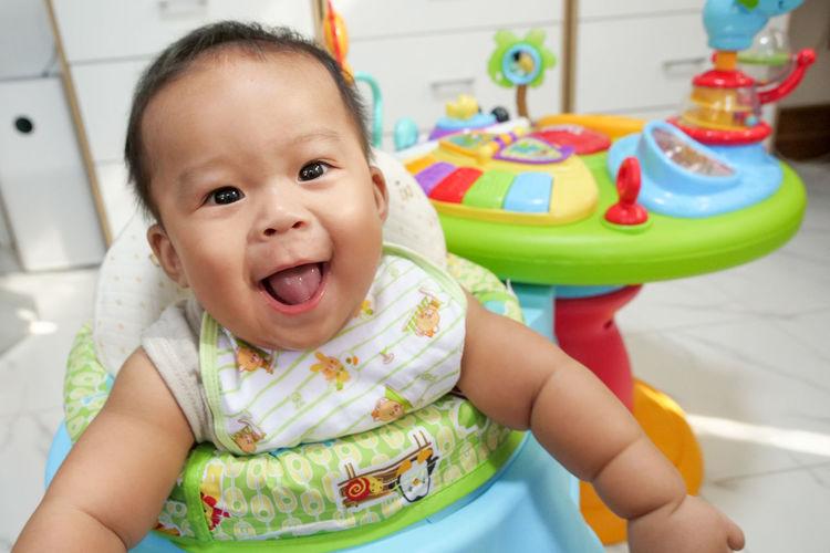 Portrait of cute baby boy smiling