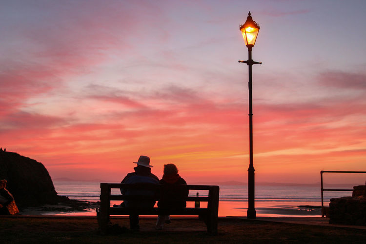 Adults Only Littlehaven Wales UK Beach Beauty In Nature Day Horizon Over Water Leisure Activity Lifestyles Outdoors Pembrokeshire Coast Real People Relaxation Scenics Sea Silhouette Sitting Sky Street Light Sunset Togetherness Tranquil Scene Tranquility Two People Water