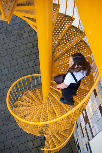 High angle view of girl sitting in playground