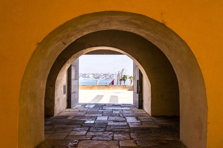 Man seen through archway