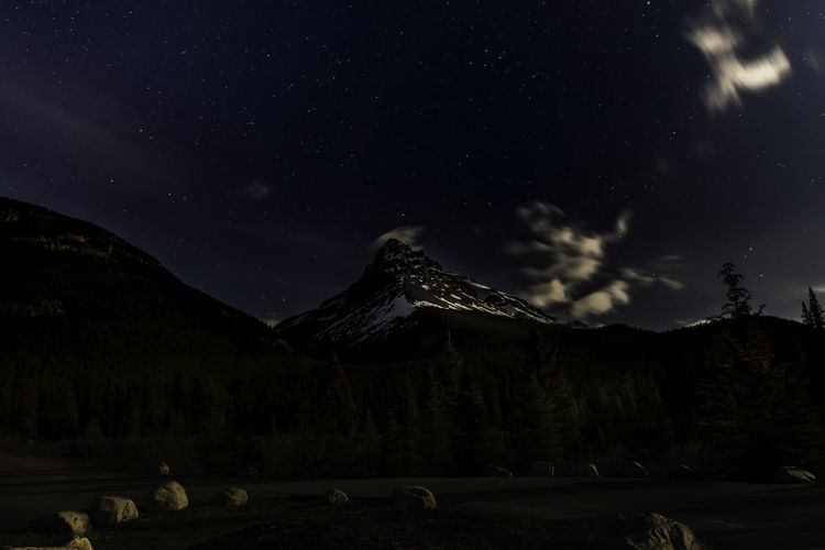 Beautiful star filled sky above rocky mountains