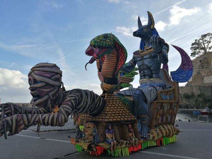 Maiori, Campania, Italy - March 4, 2019: Allegorical floats in the square of the port for the 46th edition of the Grand Carnival of Maiori Italy Campania Salerno Italy Grand Carnival Of Maiori Amalfi Coast Colorful Floats Carnival - Celebration Event Allegorical Floats Maiori, Day Art And Craft Sculpture Statue Creativity Human Representation Sky Craft Cloud - Sky Multi Colored Male Likeness Outdoors Dragon Demon - Fictional Character Warm Clothing