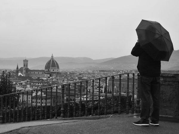 Rainy day in florence One Person Loneliness City Outdoors Adult Welcome To Black EyeEm Gallery Ladyphotographerofthemonth Sadness Rainy Day Person With Umbrella Unbrella Looking Down Cityview Grey Atmosphere Grey And Black Florence Italy Tristesse Travel Destinations Neighborhood Map View From Piazza De Michelangelo