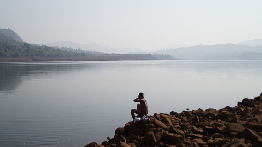 Beauty In Nature Clear Sky Day Full Length India Lake Leisure Activity Lifestyles Mountain Mountain Range Mulshi Nature One Person Outdoors Pune Real People Rock - Object Scenics Sky SonyAlpha58 Tranquil Scene Tranquility Water Young Adult
