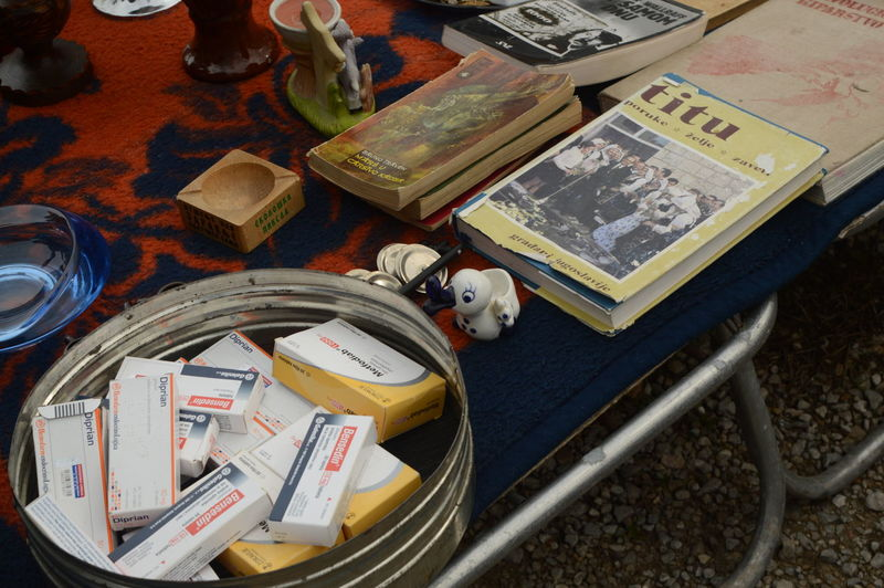 on the flea market On The Flea Market Fleamarket Dictators Go With Medicines TitU Street Artefacts High Angle View No People Day Close-up