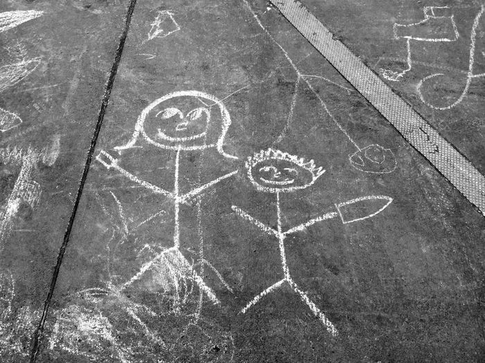 a child's chalk drawing on pavement Chalk Drawing Child Childhood Childhood Memories Close-up Drawing High Angle View Human Representation