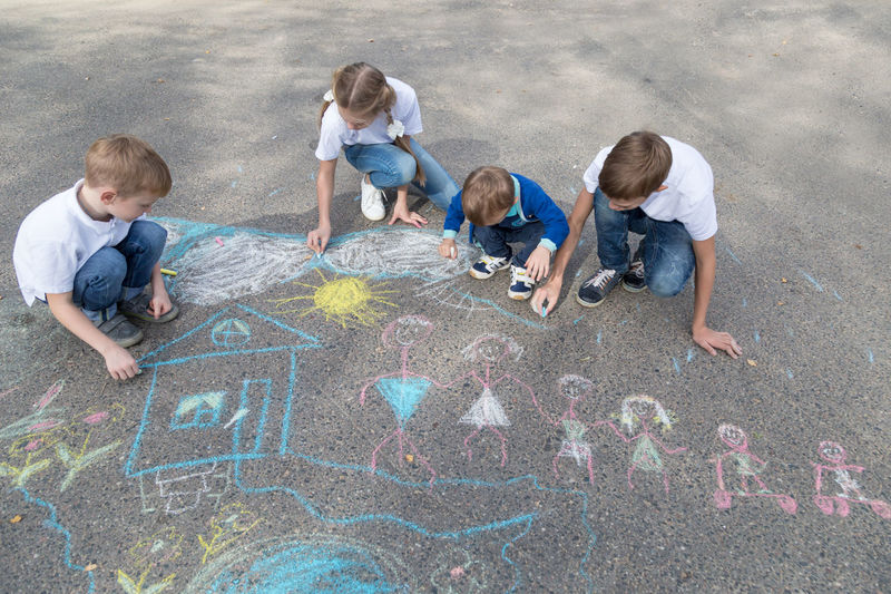 children draw in crayon on asphalt Happiness Sunshine Friendship Doodle Sketching Game Chalking Pavement Colorful Activity Creative Playground Happy Lifestyle Playing Coloring Painting Leisure Activity Leisure Education Artist Sun House Play People Image Draw Art Outside Street Sidewalk Close Up Color Fun Outdoor Day Summer Crayons Children Family Chalk Drawing Asphalt Creativity Child Childhood Copyspace Copy Space Teenager Teen