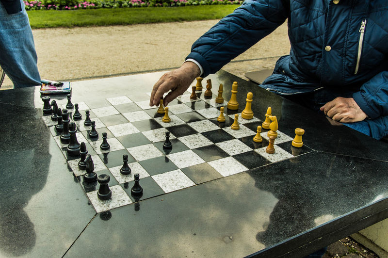 Senior man playing chess in the park