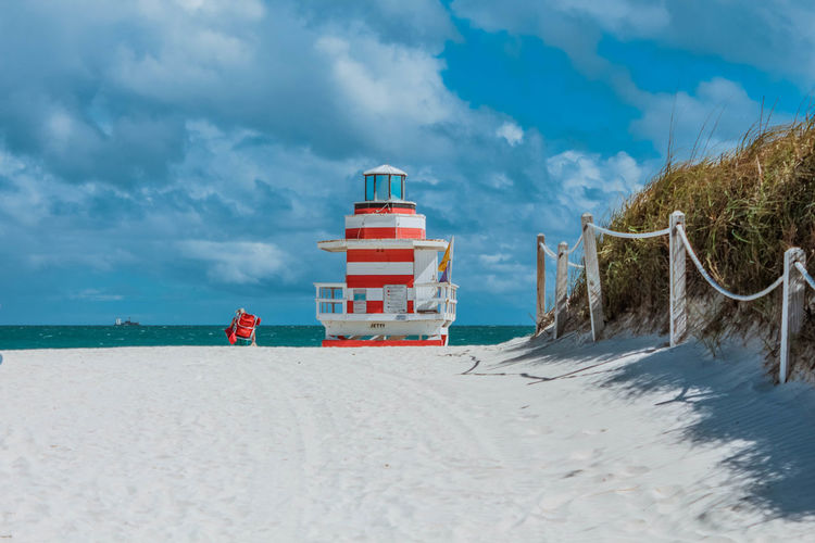 lifeguard tower on a beach with white sand Sky Cloud - Sky Beach Sand Land Sea Nature Water Tranquil Scene Day Tranquility Beauty In Nature Scenics - Nature Outdoors Non-urban Scene No People Transportation Safety Idyllic Lifeguard  Lifeguard Hut