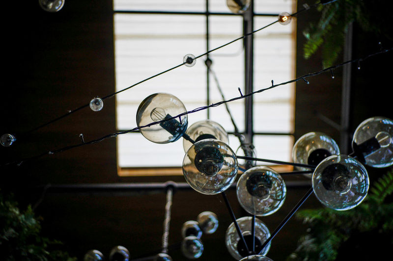 Low angle view of bubbles hanging from window
