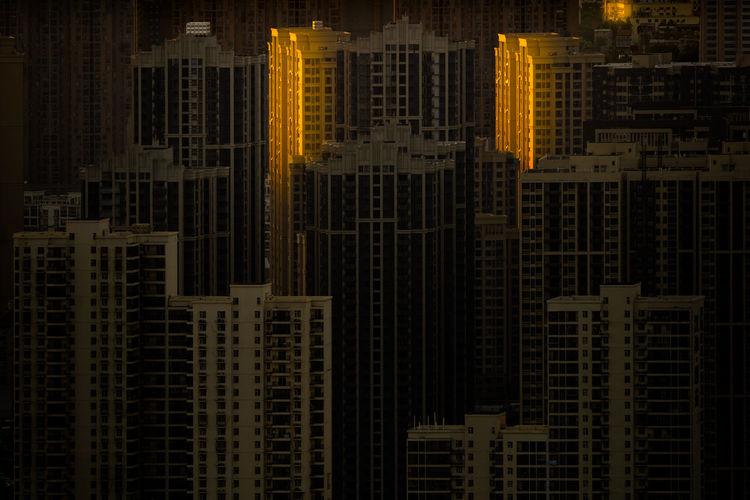 Full Frame Shot Of Modern Buildings At Night