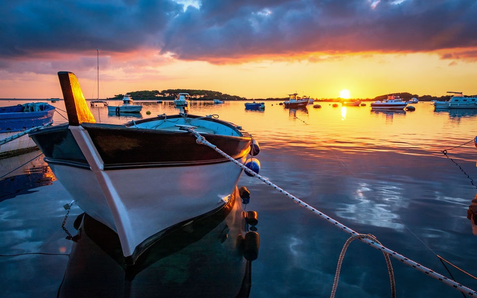Water Sunset Sky Nautical Vessel Mode Of Transportation Transportation Cloud - Sky Moored Nature Orange Color Sea Rope Beauty In Nature Reflection No People Scenics - Nature Tranquility Outdoors Idyllic Fishing Boat
