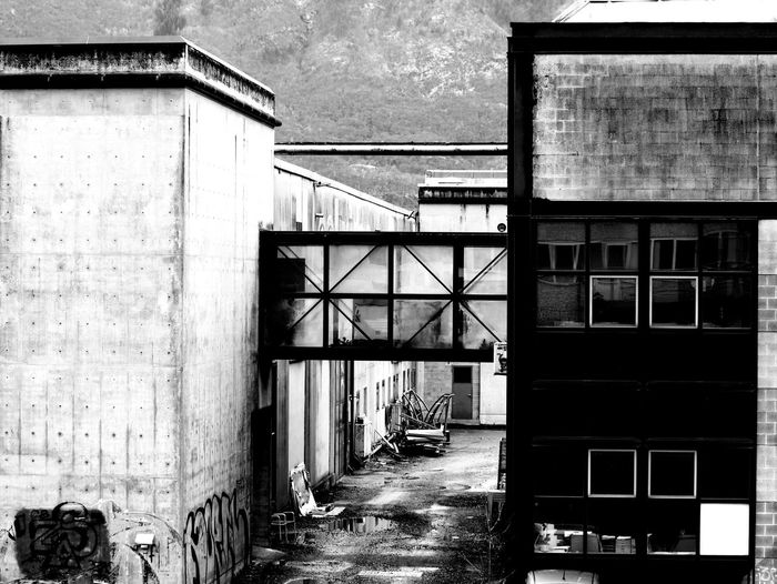 Abandoned Architecture Bnw Bnw_captures Bnw_collection Bridge Building Exterior Built Structure Day Factory High Contrast Industry No People Outdoors Reflection Run Down Sky Warehouse
