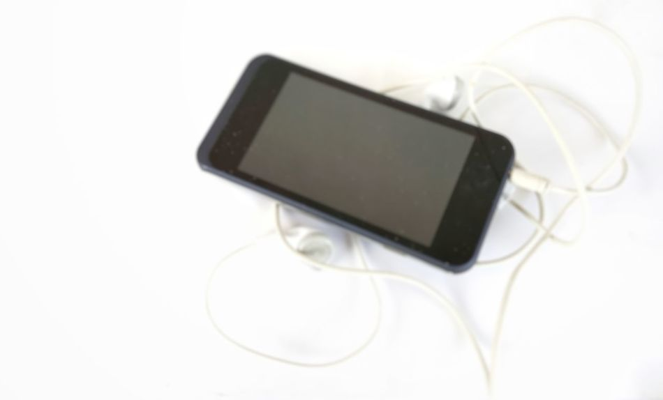 smartphone blur picture on white background Technology White Background Wireless Technology Computer Photography Themes Portable Information Device Close-up Usb Cable Electric Plug Wired Modem Cable Electrical Component Input Device Network Connection Plug Hard Drive Keyboard