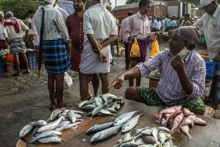 Group of people at fish market