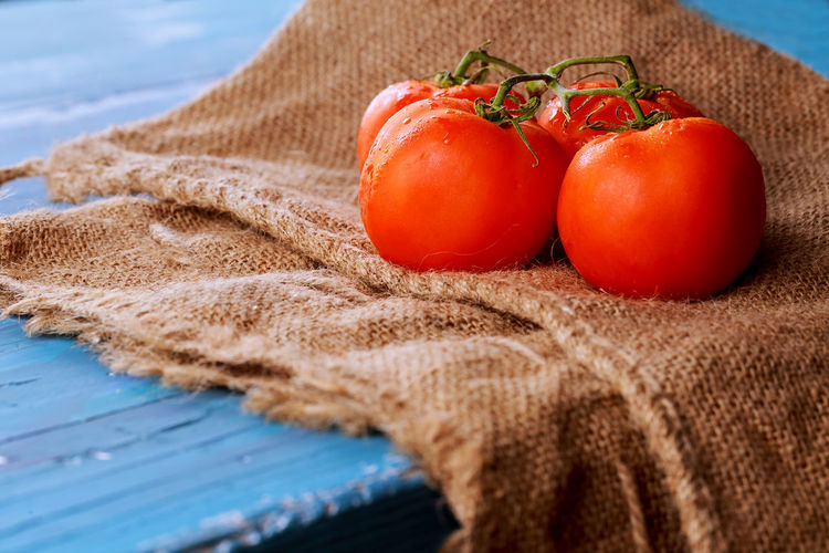 Tomatoes on burlap over table