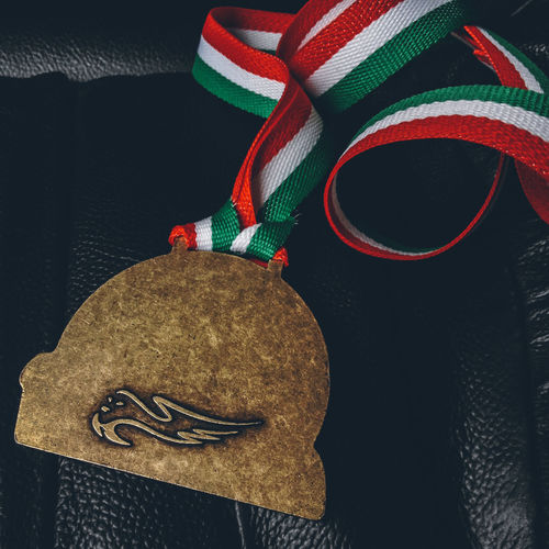 High angle view of hat hanging on fabric