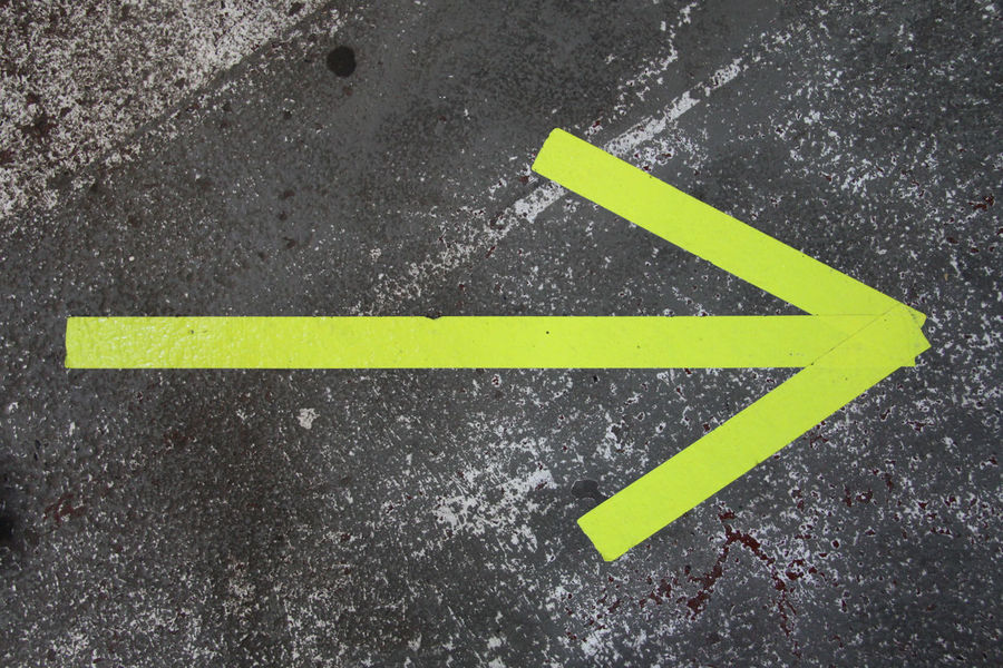 Arrow Arrow Sign Arrow Symbol Asphalt Backgrounds City Close-up Communication Day Direction Gray Guidance Marking No People Road Sign Street Symbol Yellow