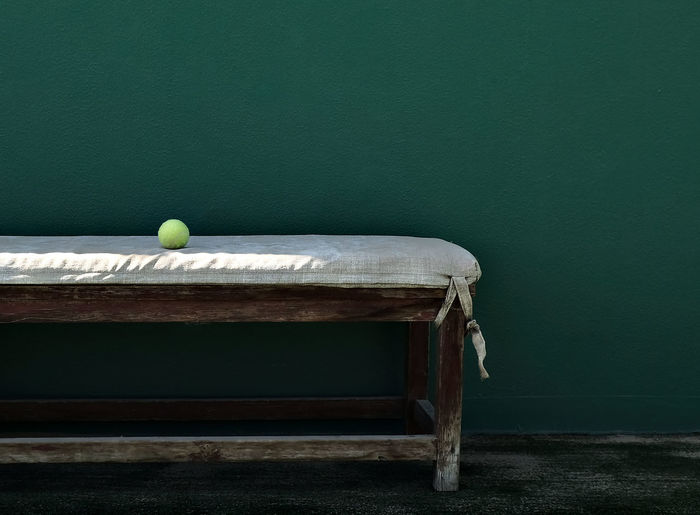 Ball on seat against wall