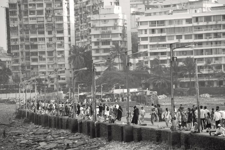 India Mumbai Adult Architecture Building Building Exterior Built Structure City City Life Crowd Day Group Of People Large Group Of People Leisure Activity Lifestyles Men Monochrome Nature Outdoors Real People Skyscraper Street Street Photography Wet Women