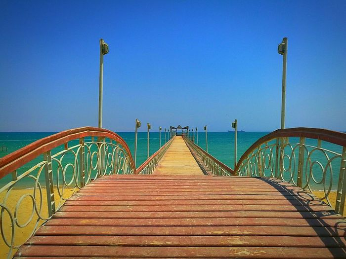 Path of relaxation.❤ Blue Railing Clear Sky Vacations Travel Destinations Outdoors Sea Bridge - Man Made Structure No People Sky Elevated Walkway Day Golden Sand Sea And Sky Sea Egypt Sokhna Summer Marina Finding New Frontiers Snow Sports