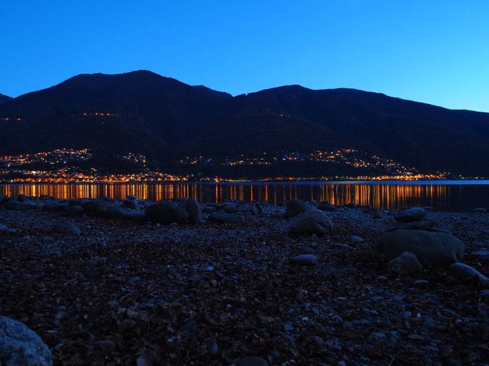 Beauty In Nature Dusk Illuminated Lake Lights In The Dark Mountain Mountains Nature Night No People Outdoors Reflection Rocks Rocks And Water Scenics Sky Tranquil Scene Tranquility Water