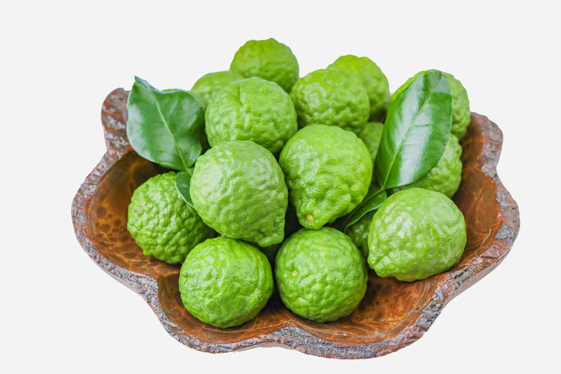 High angle view of green fruits on white background