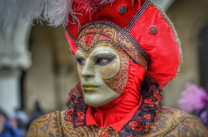 Close-up of person wearing mask standing outdoors