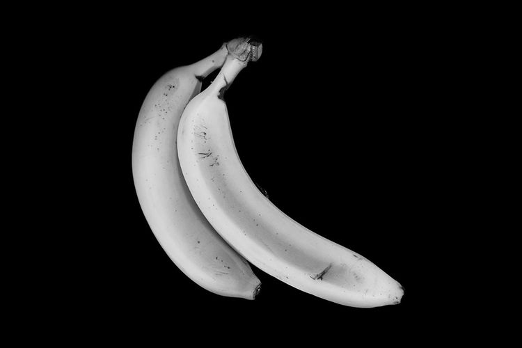 Close-up of banana against black background