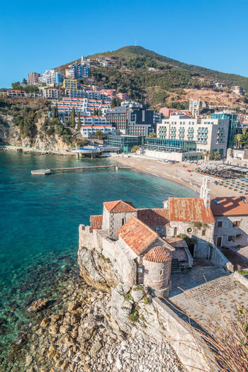Nice beach in Budva Montenegro Budva Budva,Montenegro Architecture Built Structure Building Exterior Water High Angle View Nature Building Sea Residential District Mountain Day City No People Blue Outdoors Sunlight Land Travel Destinations Sky TOWNSCAPE