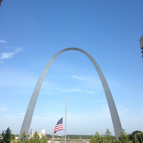 Low angle view of st louis arch against sky on sunny day