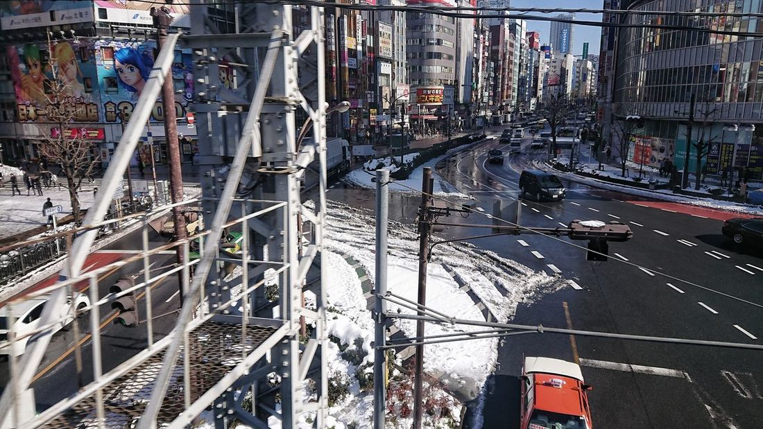 View From Train Window From Train Window After Snowing Day Melting Snow Crossing The Road Cars Buildings Wet Road Reflection Light And Shadow Winter Shinjuku Tokyo,Japan Built Structure City