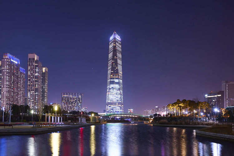 Architecture Building Exterior Night Built Structure Illuminated City Building Sky Office Building Exterior Water Tall - High Skyscraper Waterfront Landscape Travel Destinations Reflection Tower River Modern Cityscape No People Outdoors Financial District  Nightlife Songdocentralpark
