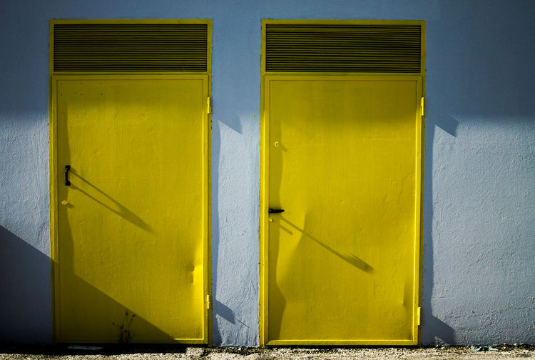Couple of Yellow doors Autumn Light Paint The Town Yellow The Week On EyeEm Architecture Black Building Exterior Built Structure Close-up Color Day Door No People Outdoor Photography Outdoors Shadow Yellow Yellow Color