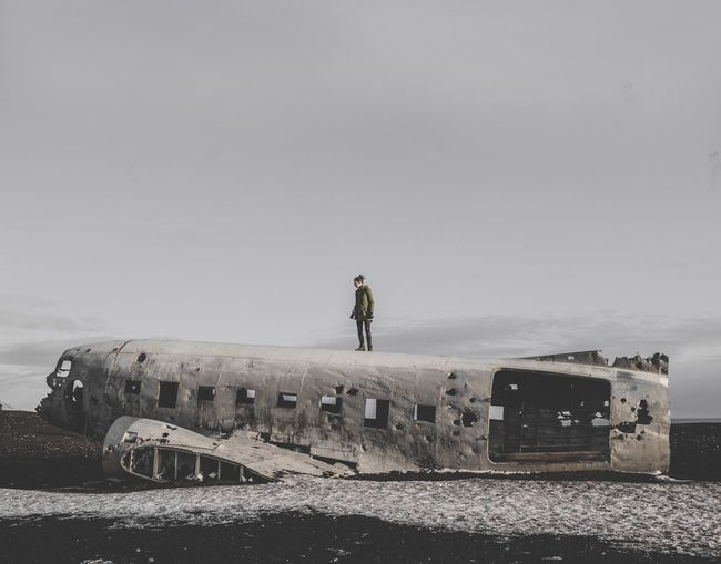 'Destination Unknown' | Sigma 20mm 1.4 Standing Full Length Leisure Activity Abandoned Outdoors One Person History Day Men Lifestyles Sky Sea Nature Young Adult People Woman Crash Plane Crash DC-3 Iceland Iceland_collection Sólheimasandur Explore Wreck Plane Breathing Space Breathing Space EyeEm Selects EyeEm Selects Breathing Space The Week On EyeEm Your Ticket To Europe Lost In The Landscape Perspectives On Nature Go Higher Go Higher The Traveler - 2018 EyeEm Awards
