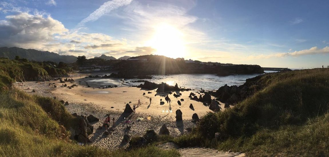 Nature Sunlight Beauty In Nature Sky Outdoors Beach Sea Water Sun Mountain Scenics Large Group Of People Day People SPAIN EyeEm Best Shots Enjoy The New Normal Seaside Asturias Llanes EyeEm Nature Lover EyeEmBestPics Tranquil Scene Sunset From My Point Of View