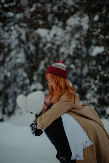 Woman with umbrella in winter