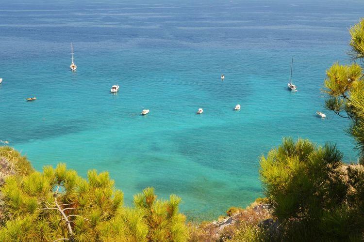 High Angle View Of Boats Moored At Sea