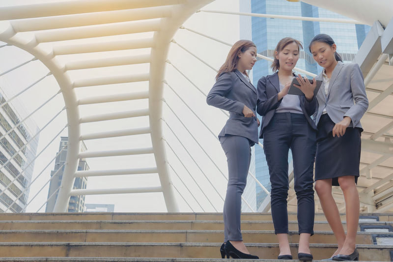 Architecture Business Businesswoman Corporate Business Day Friendship Full Length Indoors  Leisure Activity Lifestyles Low Angle View People Railing Real People Staircase Steps Steps And Staircases Togetherness Two People Well-dressed Women Young Adult Young Women