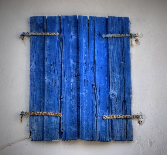 closed blue hinges in Parga, Greece Ancient Architecture Blue Blue Color Building Built Structure Close Up Close-up Closed Day Greece Hinges No People Outdoors Parga Protection Safety Siesta SiestaTime Window Window Shutters Minimalist Architecture
