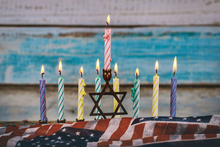 Colorful candles from a burning hanukkah candles in a menorah Channukah Glitter Hannukah Hanukkah Menorah Hanukkah Candles HanukkahDecor Menorahcandles Star Of David Candle Flame Hannukahcandles Hannukkah Hanukkah Hanukkah Dreidel Hanukkiah Judaism Kislev Menorah Menorah, No People