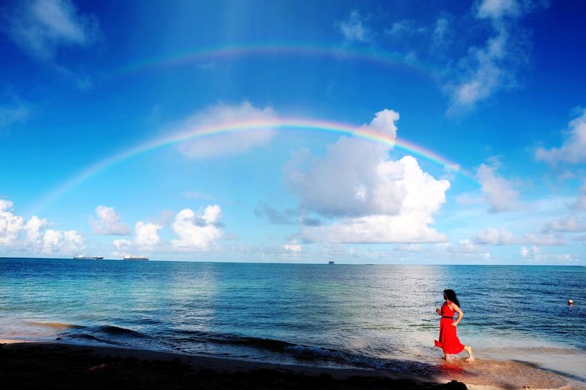 Sky Sea Water Cloud - Sky One Person Beauty In Nature Horizon Beach Horizon Over Water Land Scenics - Nature Standing Rainbow Nature Rear View Leisure Activity Real People Idyllic Outdoors