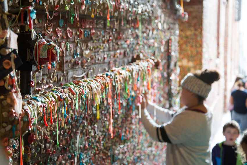 People in the bubblegum alley in Seattle's Pike Place Market. Bubblegum Bubblegum Wall Candy Chewing Gum Chewing Gum Wall Color Colorful Colourful Colours Disgusting  Gross Gum Gum Wall People Pike Place Pike Place Market Seattle Smelly Tourists Tradition Travel Travel Destinations Traveling Unhygienic Wall