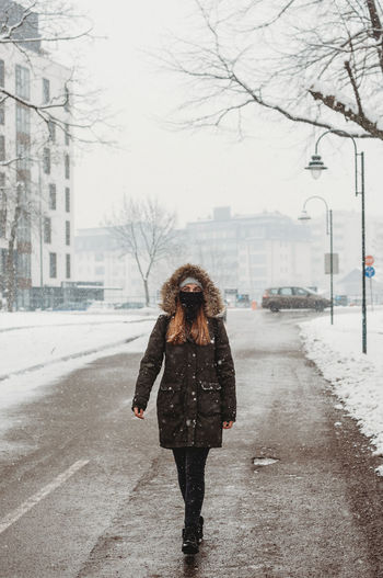 Woman standing on road in winter