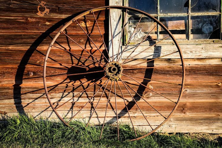 Old Wheel Outside House