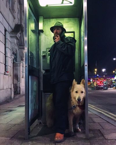 Hackney phone call Art Is Everywhere Streetphotography Street Photography Candid Phonebooth Man Dog Street London Style Fashion Underground Telling Stories Differently Up Close Street Photography The Street Photographer - 2016 EyeEm Awards People And Places London Lifestyle
