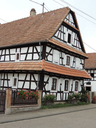 Alsace Architecture Building Exterior Built Structure City Clear Sky Day Engineering Exterior House No People Outdoors Residential Building Residential District Residential Structure Road Sky Street Village Weathered